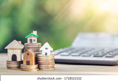 House is placed on the coins. The concept of calculation to buy a house. planning savings money of coins to buy a home concept for property, mortgage, real estate investment and savings to buy a home.
