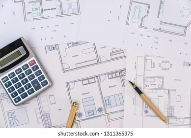 House plan with pen and calculator close up