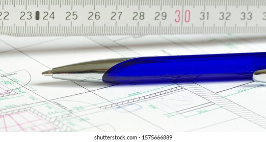 House planning with blue pen and pocket rule