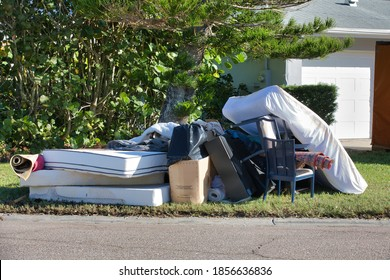 House possessions on the curb after flooding from a tropical storm in St. Petersburg, FL.