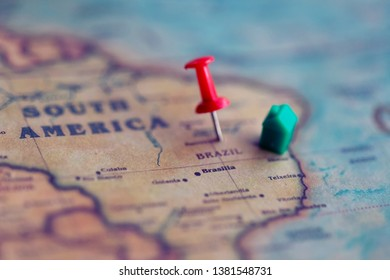 House and pushpin on Brazil part of world map. Real estate in Brazil concept.