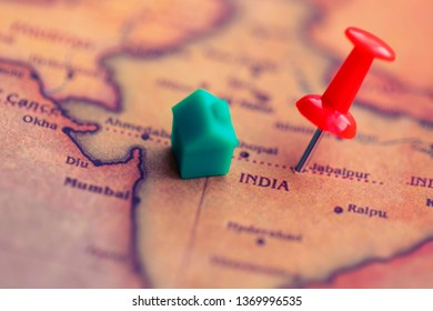 House and pushpin on India part of world map. Real estate/residence/ citizenship in India concept.