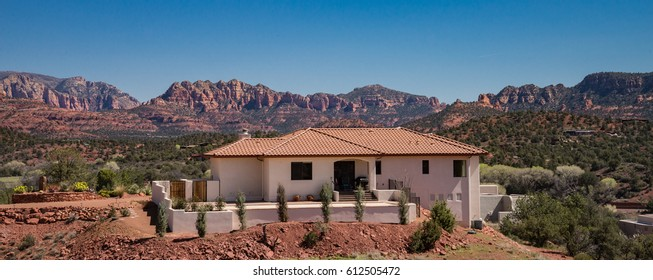 House with a red rock view