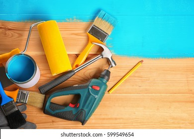 House renovation tools on turquoise painted wooden background