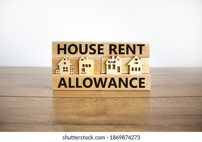 House Rent Allowance symbol. Wooden blocks with words 'House Rent Allowance', miniature houses. Beautiful wooden table, white background, copy space. Business and House Rent Allowance concept. - Shutterstock ID 1869874273