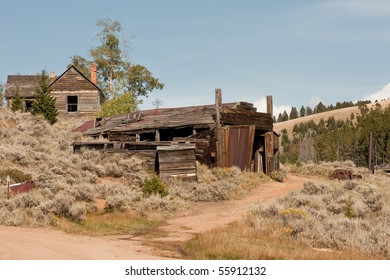 House, repair shop, vehicle, and more in a Montana ghost town that was abandoned in 1941