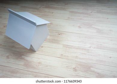 House replica on wooden background