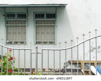 House with retro window frame and spike flowers in front