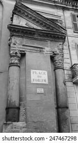 A house with Roman portico and columns at Forum square (Place du Forum) in Arles (Provence, France). Aged photo. Black and white.