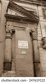 A house with Roman portico and columns at Forum square (Place du Forum) in Arles (Provence, France). Aged photo. Sepia.