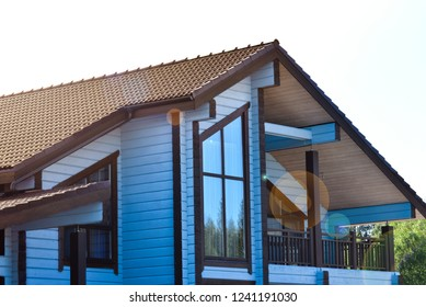 A house with a roof. The house with gables, windows and roof. Natural photo.