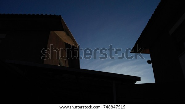 House roof silhouette.