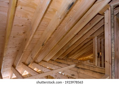 House room interior under construction unfinish wooden roofing of beam frame for building