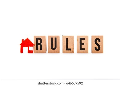 House Rules - block letters with red home / house icon with white background