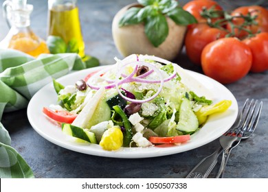 House salad with fresh vegetables picled pepper and feta cheese