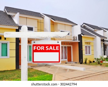 House for sale board with house background. You can put your number on the board