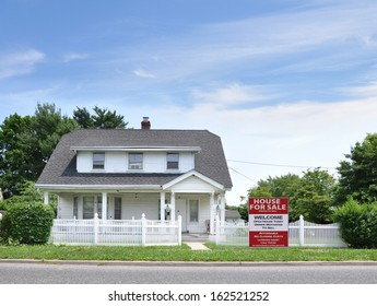 House For Sale White Picket Fence Suburban Home Residential Neighborhood Blue Sky Clouds USA