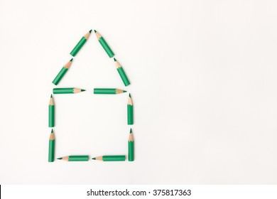 House shape build from green pencils - concept image for real estate, mortgage, green building, construction