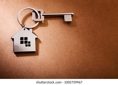 house shape keyring on the wooden background
