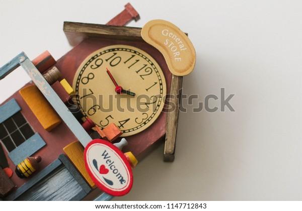 House shaped clock on white background
