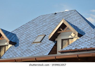 House with shingle roof blue color