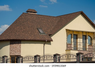 House with shingle roof brown color