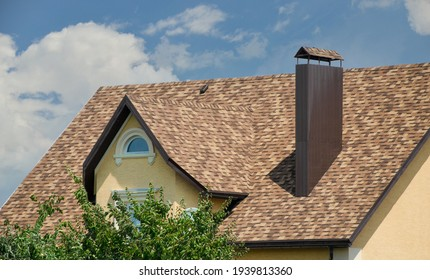 House with shingle roof coffee color