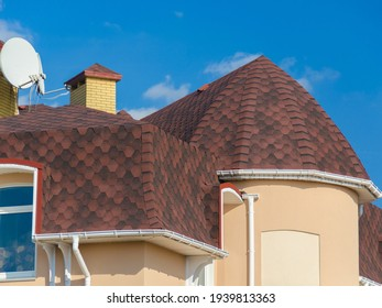 House with shingle roof red color