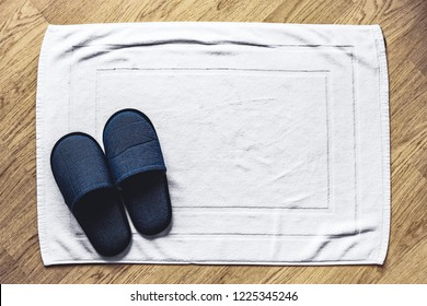 house slippers on white carpet