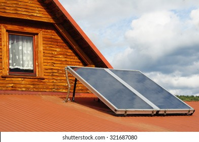 house with solar panels in summer and wood heating in winter, green energy
