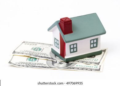 the house stands on dollar money isolated background