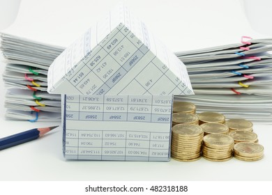 House with step pile of gold coins and pencil have pile overload document of report with colorful paperclip as background.