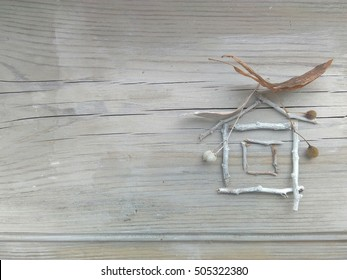 a house of sticks on wooden background