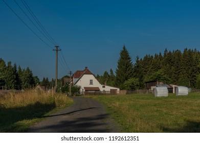 House in Studena Kuchyn village in Krusne mountains in hot summer morning - Shutterstock ID 1192612351