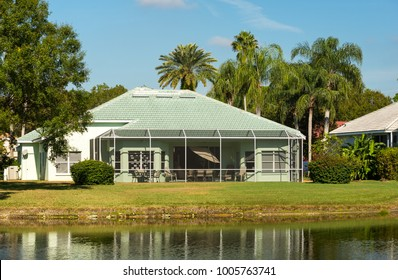 House with a sunroom on a lake