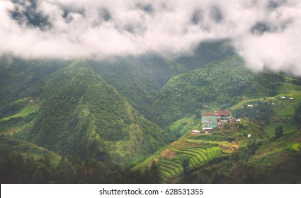 House surrounded by mountains in Sapa Vietnam.
