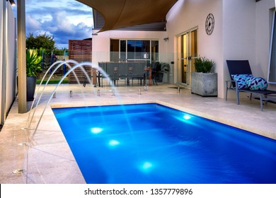 House with swimming pool and water feature