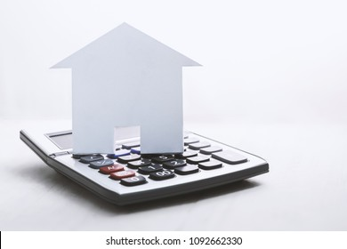 house symbol with calculator on white background