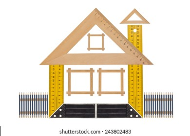 House of the tools,  Metallic tool to measure right angle, triangle and wooden ruler, pencil and tape measure on a white background