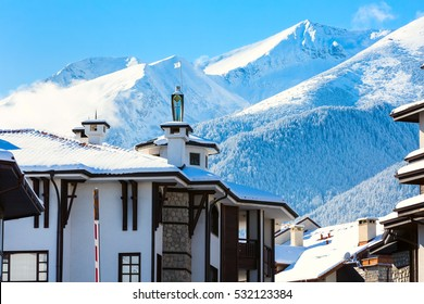 House with tower and snow mountains panorama in bulgarian ski resort Bansko, Bulgaria