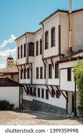 House with a typical Revival architecture and Eastern Orthodox church in the background. Traditional houses from the Revival Period in Bulgaria are what you see in Old Towns across the country.