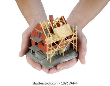House under construction carried on hands