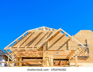 House under construction. The site with wooden frame.