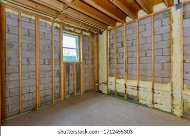House in unfinished under construction in insulation foam the wall of a basement