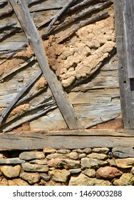 House wall build with traditional building materials: wood, stone and cob