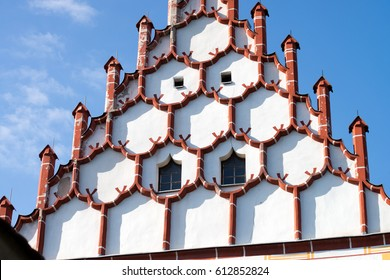 house wall at a castle with many little towers
