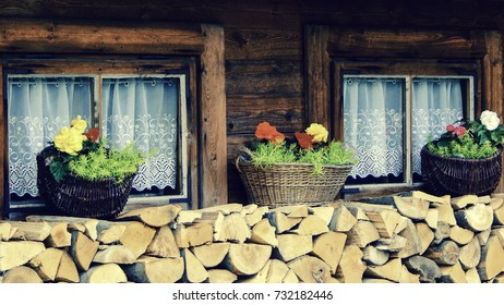 House windows with flower pots and wood,  home sweet home