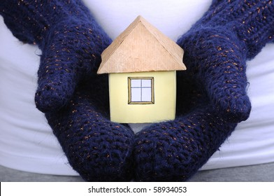 House and winter gloves on the white background