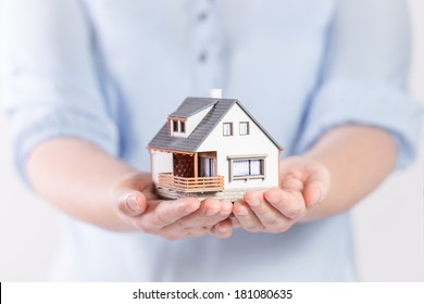 House in woman's hands