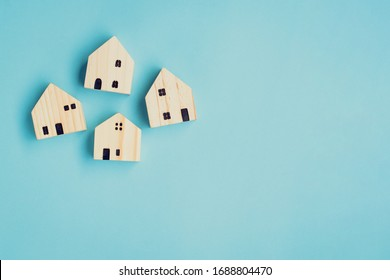 house wood model concept on blue background and copy space for your text